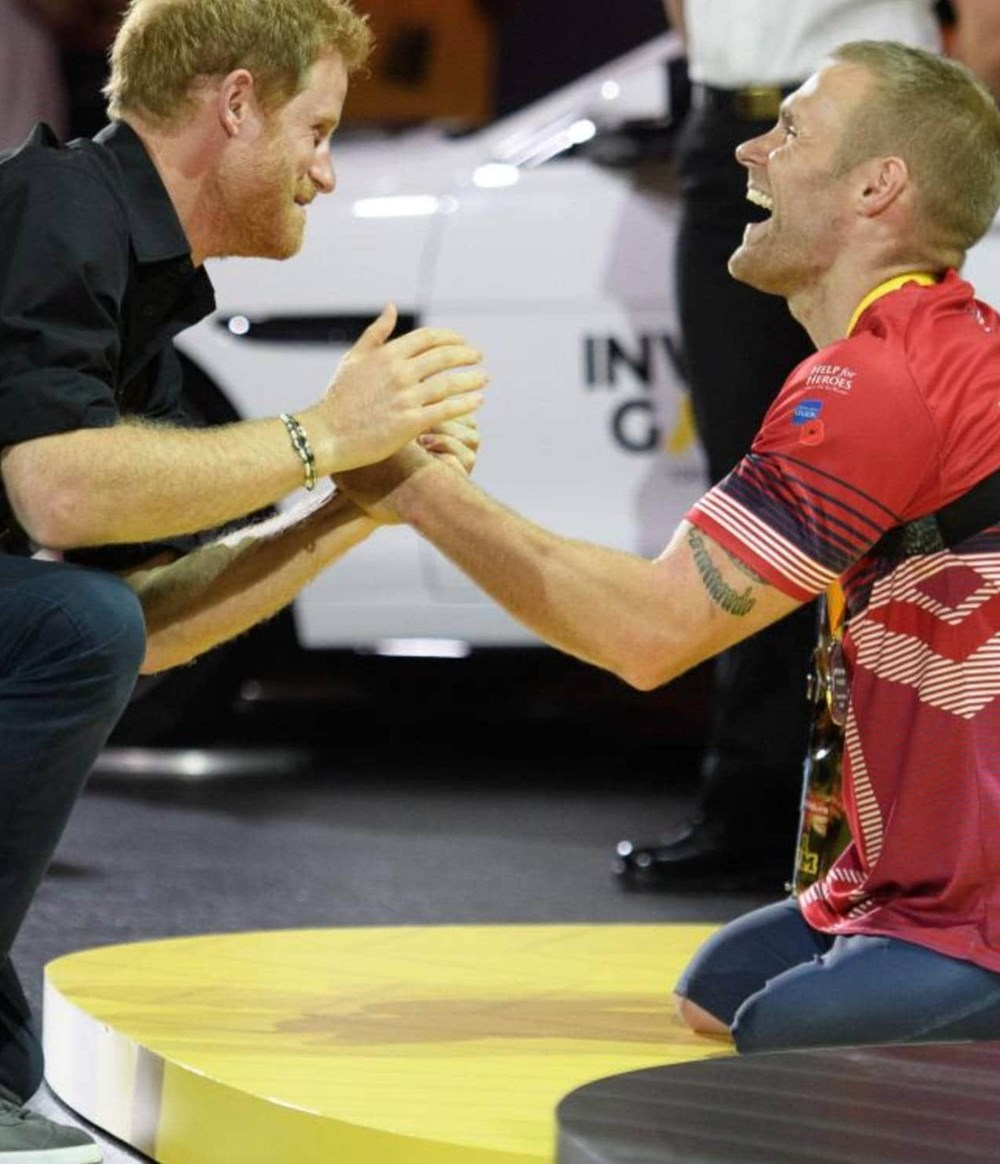 Prince Harry with injured Veteran