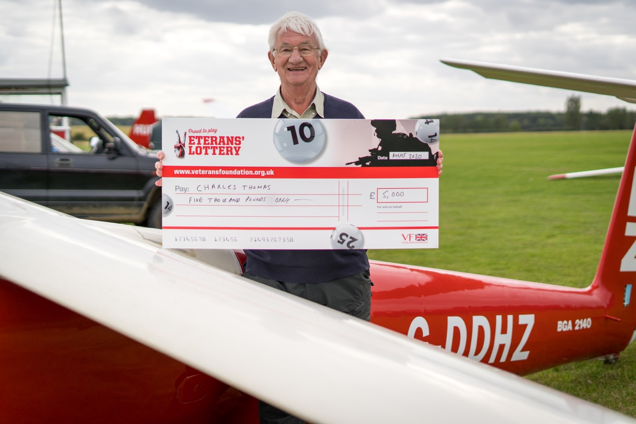 Man holding giant cheque