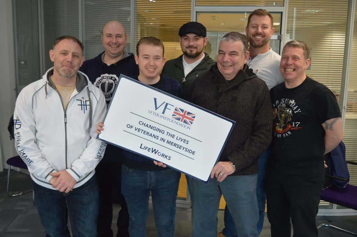 Veterans holding Cheque from charity